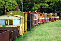 Old industrial diesel train with several carriages