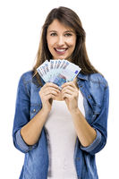 Woman holding some Euro currency notes