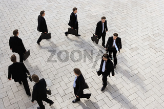 Businessman walking round in circles