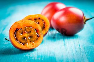 Fresh tamarillo fruit on wooden background