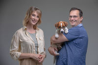 Happy family in studio with pet