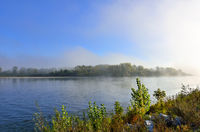 Early foggy morning over the rivr - beautiful summer landscape