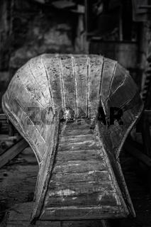 Old wooden chinese boat in repair workshop