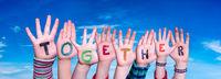 Children Hands Building Word Together, Blue Sky