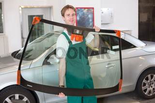 Glazier with car windshield made of glass