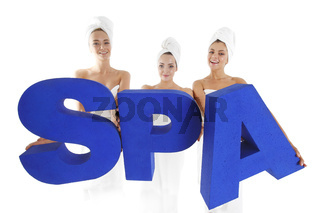 Young women holding spa letters