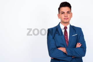 Portrait of young handsome multi ethnic businessman in suit