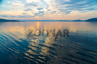 midnight sun over a fjord