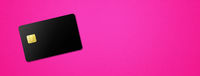 Black credit card on pink background