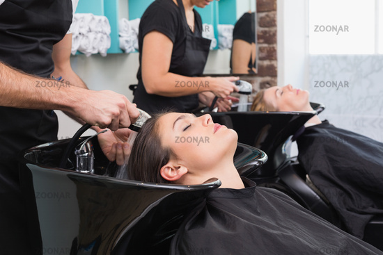 Hairdressers washing their clients hair