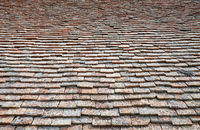 Texture of terracota tiles. Old weathered tile roof background