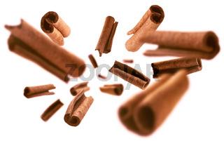 Cinnamon sticks levitate on a white background