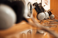 vintage headphones on a rustic or bare wooden table wall