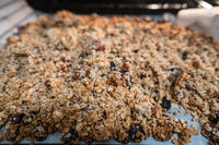 granola to cook in an electric oven. concept of simple ingredients for healthy breakfast