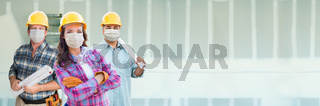 Female and Male Contractors In Hard Hats Wearing Medical Face Masks At Construction Site During Coronavirus Pandemic Banner
