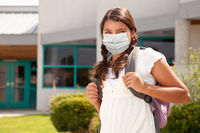 Hispanic Student Girl Wearing Face Mask with Backpack on School Campus