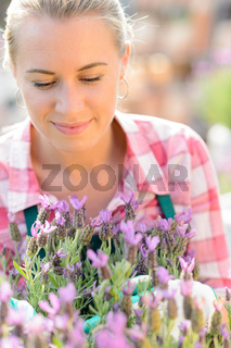 Garden center woman with purple potted plant