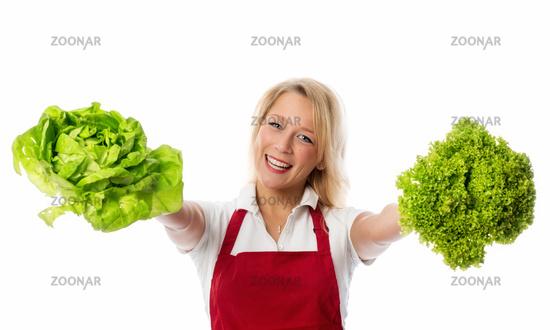 blonde woman presented salad heads