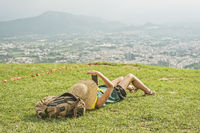 woman lie on grassland and using cellphone