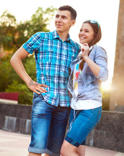 Students or teenagers outdoors in summer evening