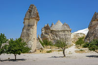 Typical rock formations in the Cappadocia region, Turkey and blue sky