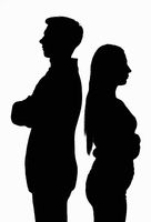 A silhouetted contoured black white portrait of a young couple standing with their backs to each other