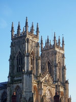 a view of the towers at the front of york minster in sunlight