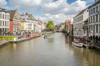 View of colorful traditional houses along the canal and boats in Ghent