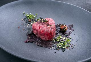 Gourmet fish tartar raw from tuna fillet with seaweed