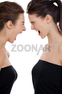 two young girls angry shouting loud isolated