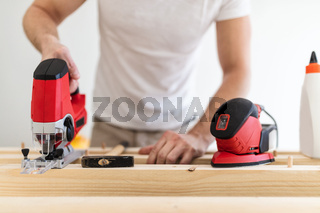 Male carpenter working on a project in his workshop