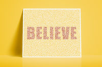 textured card with the word believe