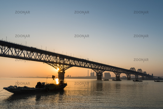 jiujiang highway and railway combined bridge in sunrise