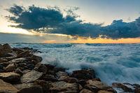 Seascape on rocky shore in storm