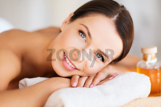 happy woman in spa salon