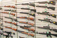 Hunting and sporting guns presented at exhibition for sale. Wide assortment of rifles are presented