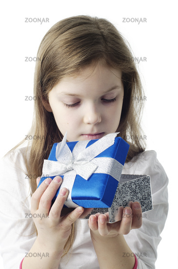 An image of young girl with gift