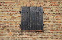 closed window shutter and red brick wall
