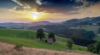 Schwarzwald landscape with dramatic sky in sunset