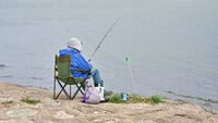 angler on the bank of the Harbour entrance in Swinoujscie on the Polish Baltic coast