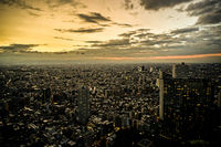 Shinjuku of city landscape and sunset visible from the observatory of the Tokyo Metropolitan Government Building