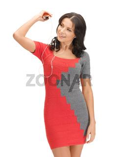 woman in elegant dress listening music