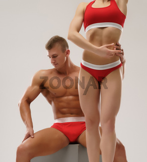 Sexy couple of bodybuilders together in studio