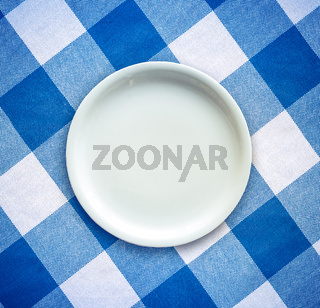 Empty Plate On Tablecloth