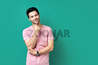 Handsome smiling young man on blue background