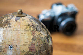 Close-up on a world map with a camera