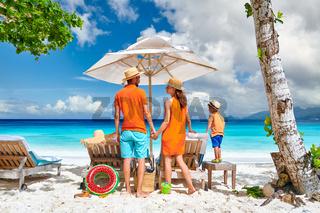 Family with three year old boy on beach. Seychelles, Mahe.