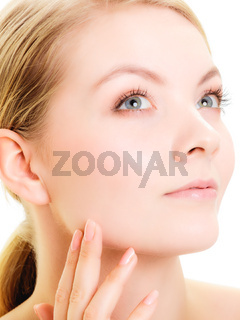 Face girl with healthy pure complexion. Skin care.