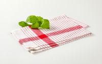 Tea towel and basil leaves