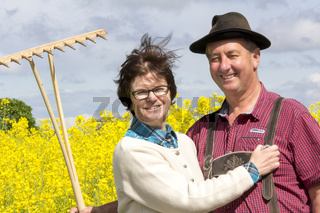 Farmer with his wife before the rape field